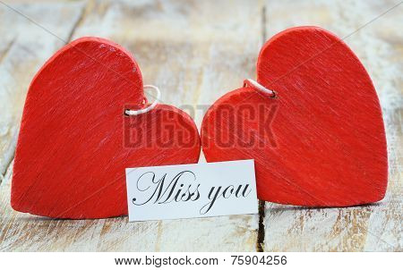 Miss you card with two red wooden hearts