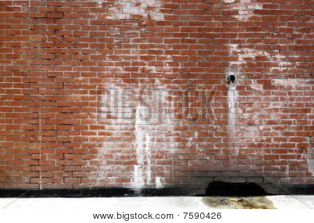 Leaking brick wall