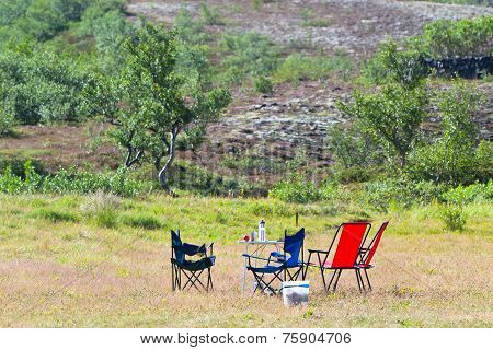 Camping Site With Camp-chairs And Table