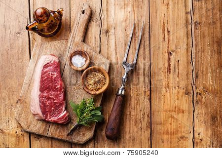 Raw Fresh Meat Of South American Premium Beef New York Steak Striploin On Wooden Background
