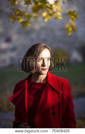 Woman At Autumn Park With Certain Look