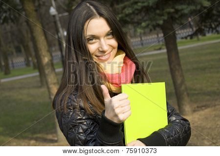 Student In The Park With A Folder