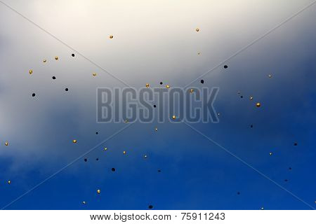 Yellow And Black Balloons In The Sky