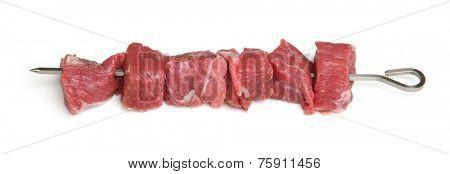 Lamb steak meat on metal kebab skewer