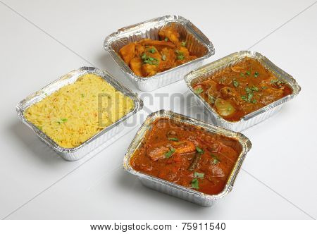 Indian takeaway curry meal in foil containers