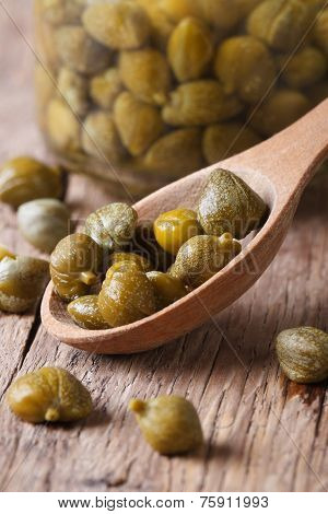 Ripe Capers In A Wooden Spoon Macro Vertical