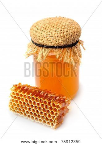 Honeycomb  And Honey Close Up On A White Background