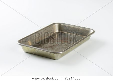 old baking tray on white background