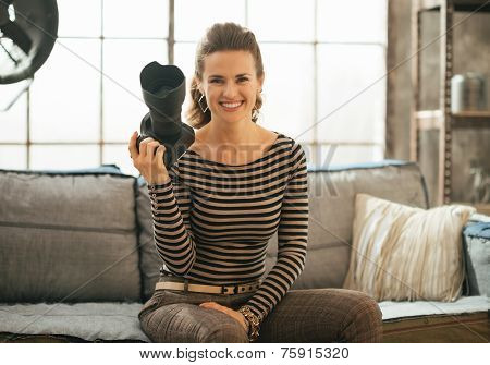 Portrait Of Smiling Young Woman With Dslr Photo Camera Sitting I