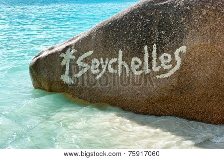 Close up Seychelles Text on Granite Rock at Anse Lazio Beach, Praslin Island.