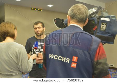 NOVOSIBIRSK, RUSSIA - NOVEMBER 7, 2014: Unidentified athlete gives an interview to the press before the Friendship Cup. The competitions in 10 kinds of martial arts will start on November 8
