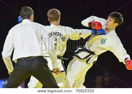 NOVOSIBIRSK, RUSSIA - NOVEMBER 8, 2014: Taekwondo match Adlan Bisayev (red gloves) vs Evgeny Otsimik during the Friendship Cup. The competitions include 10 kinds of martial arts