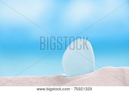 sea glass seaglass with ocean , white sandy beach and seascape, shallow dof