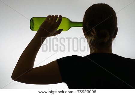 Silhouette Of An Alcoholic With A Bottle