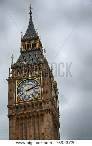Close up detail of the clocks on Big Ben, London, showing the ornate Gothic style stone facade and dials of the clocks