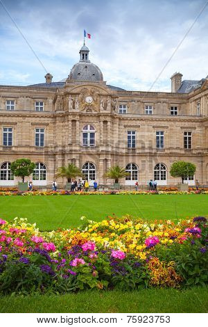 Palace And Colorful Flowers Of Luxembourg Garden In Paris