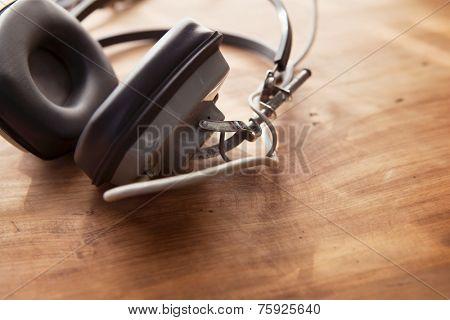 Recording scene. Headphones on a wooden desk