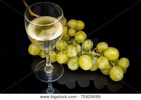 Glass of wine on black