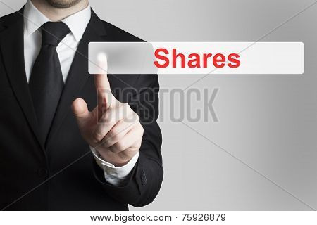 Businessman Pushing Flat Touchscreen Button Shares