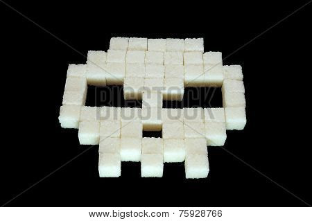 Skull from white sugar cubes. Diabetes.
