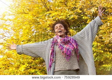 Carefree Young African American Woman With Arms Outstretched