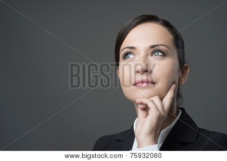 Pensive Businesswoman With Hand On Chin