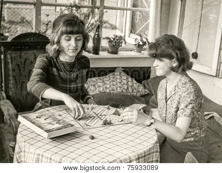 LODZ, POLAND, CIRCA SIXTIES - Vintage photo of two women playing