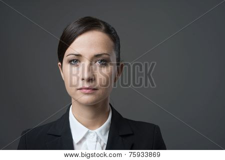 Serious Businesswoman Staring At Camera