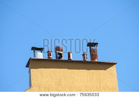 Chimney section of yellow house