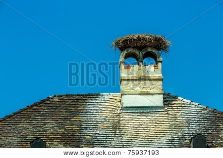 a stork's nest on a achornstein in rust. burgenland, austria