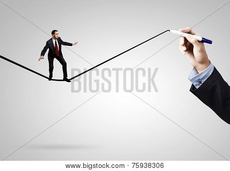 Businessman walking on drawn line. Risk concept