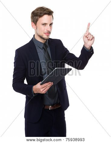 Businessman use of digital tablet and finger point up