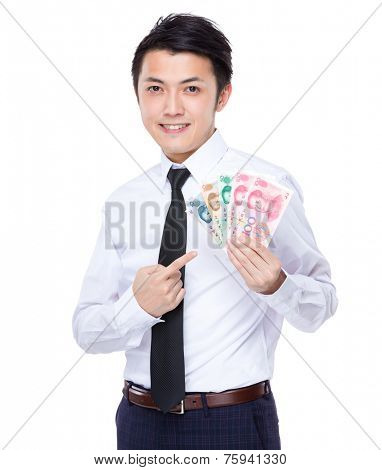 Businessman hold with renminbi banknote