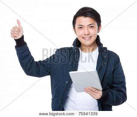 Man with tableta and thumb up