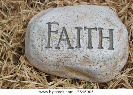 rock on ground showing faith