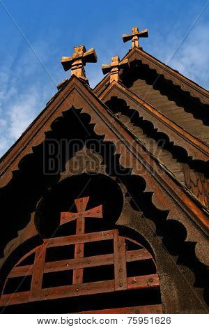 Front detail of the Reinli stave church, Sør-Aurdal, Norway, on a clear, bright sky