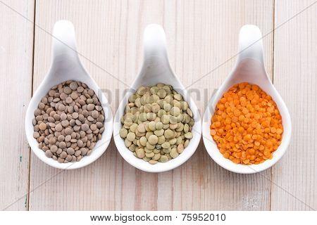 Three Kinds Of Lentil In Bowls - Red Lentil, Green Lentil And Brown Lentil