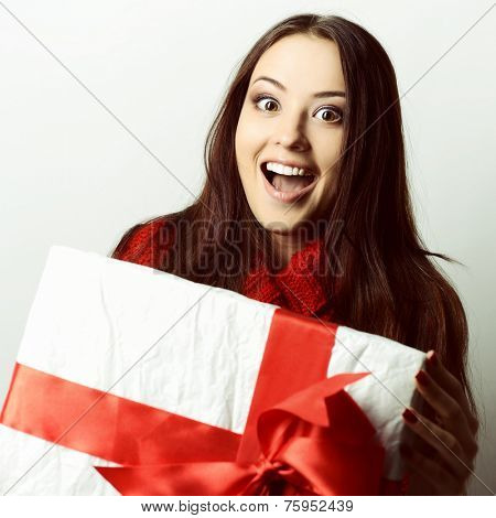 Xmas excited girl holding gift box surprised, toned