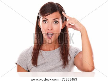 Surprised Young Woman Pointing To Her Head