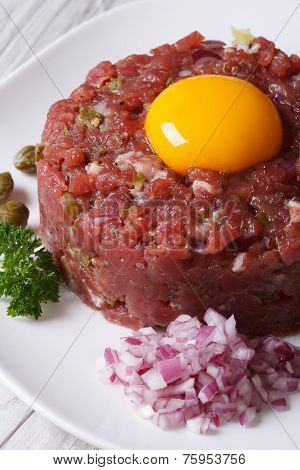 Delicious Tartare Of Beef Closeup On A White Plate