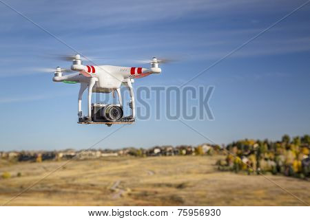 FORT COLLINS, CO, USA, October 17, 2014:  Radio controlled Phantom quadcopter drone flying over foothills with a Panasonic Lumix GM1 camera mounted on a home made platform.