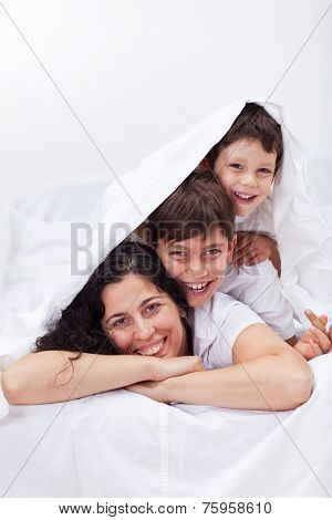 Happy woman playing with her kids - enjoying time together