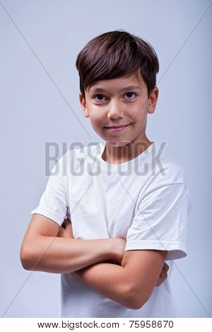 Healthy boy smiling with arms crossed -  portrait