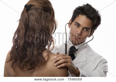 doctor listening to the heartbeat