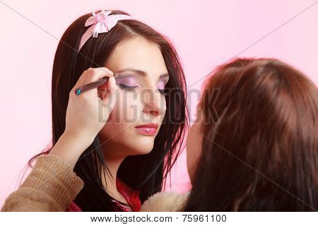 Makeup Artist Stylist Applying Eyeshadow On Eyelid Of Woman