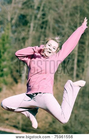 Cheerful Woman Teenage Girl In Pink Tracksuit Jumping Outdoor