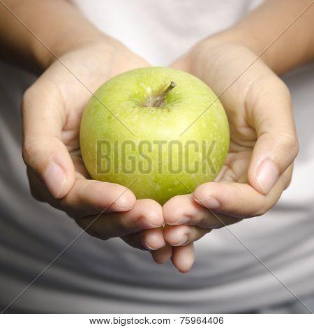 Hand Holding Apple Fruit