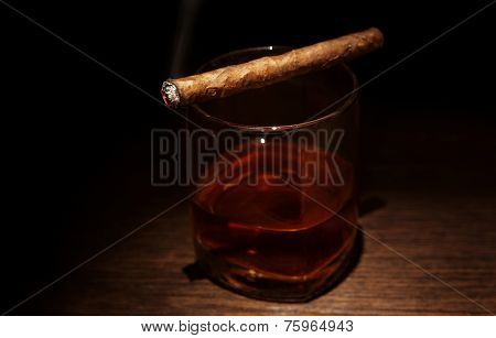 Luxury whiskey glass with cigar