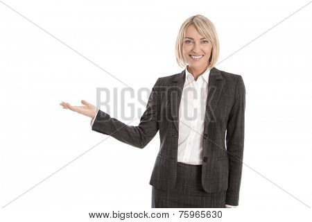 Presenting isolated business woman showing text or product with palm or hand.