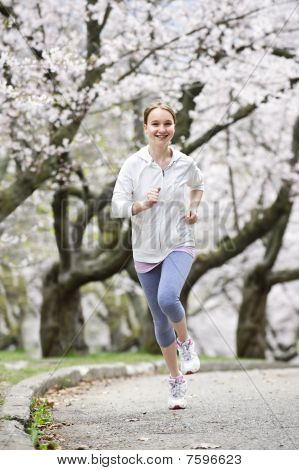 Girl Jogging In Park
